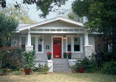 painted grey brick house | painted gray brick, white trim, red door, columns, wide trim