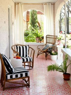 This colorful, patterned tile floor makes a big statement while the monochrome accents tie it all together. See more ways to create an outdoor porch retreat: http://www.bhg.com/home-improvement/porch/porch/outdoor-porch-design-and-decorating/?socsrc=bhgpin060113pinktile=3