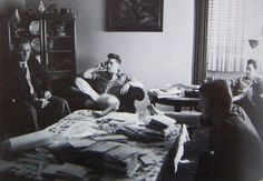 Vernon and Elvis Presley, Lamar Fike and Red West are pictured sitting in the livingroom of Elvis's rented house at Goethestraße 14 in Bad Nauheim, Germany in the spring of 1959. Note the fan mail on the table. (Elvis moved into this house on February 3, 1959. Red West had gone back to Memphis by May 8, 1959.)