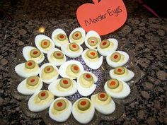 Halloween Party Tip: Turn your deviled eggs into monster eyes by adding sliced green olives with pimento on top.
