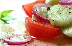 Marinated Cucumber onion and tomato salad( from Food,com: 3 medium cucumbers, peeled and sliced 1/4 inch thick  1 medium onion, sliced and separated into rings  3 medium tomatoes, cut into wedges  1/2 cup vinegar  1/4 cup sugar  1 cup water  2 teaspoons salt  1 teaspoon fresh coarse ground black pepper  1/4 cup oil  1 teaspoon chopped fresh mint (optional)