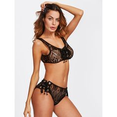 SheIn(sheinside) Grommet Lace Up Lace Sports Bra & Pantie Lingerie Set ($15) ❤ liked on Polyvore featuring intimates, black, lace lingerie, sexy lingerie, sexy lace lingerie, lacy lingerie and bow lingerie