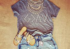God is Greater than the highs and lows tee by The Light Blonde, paired with denim, metallic sandals and a statement necklace.