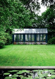designed greenhouse in petroleum blue is an eye catcher in the garden. Built from recycled windows in heartwood.Specially designed greenhouse in petroleum blue is an eye catcher in the garden. Built from recycled windows in heartwood. Outdoor Greenhouse, Best Greenhouse, Greenhouse Plans, Greenhouse Gardening, Outdoor Gardens, Homemade Greenhouse, Greenhouse Wedding, Portable Greenhouse, Greenhouse Film