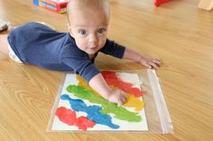 Tummy time painting... Baby's first painting and a fun tummy time activity all in one!