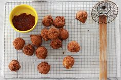 CORNMEAL HUSH PUPPIES 1 1/4 cups yellow cornmeal 1/4 cup all-purpose flour 2 teaspoons sugar 3/4 teaspoon baking powder 1/4 teaspoon baking soda 1 teaspoon salt 1/2 cup yellow onion, finely chopped 1 cup fresh or frozen corn kernels 1 egg, beaten 1/4 cup water 1/2 cup buttermilk