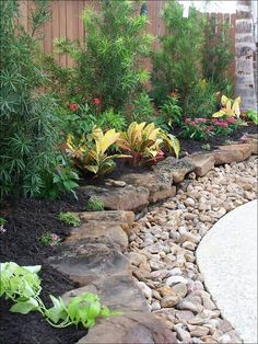 Berm; sm bushes, flagstone and sm rocks then cement-4layers