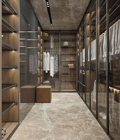 If you are lucky to have a big walk in closet, an idea can be to install glass walls like these! With door you reduce dust that is building up inside the walk in closet and preserves your precious clothes, bags and shoes design by @yodezeen_architects