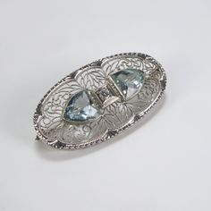 white gold filigree brooch with one diamond and a matching pair of aquamarine gemstones. Circa 1930-40
