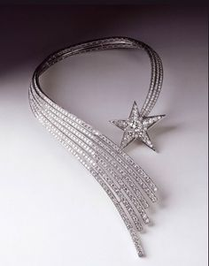 At the center of Coco Chanel's 1932 Bijoux de Diamants jewelry collection is the Comète, a spectacular 649-diamond collar in the form of a shooting star. Despite its obvious opulence, a perfect purity of line keeps it from being flashy . . . and, moreover, makes it as chic today as it was way back when.