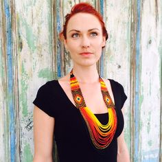 Diamante. This warm coloured design embodies the traditional symbolism that represents rays of sunshine. Beaming directly towards the heart, it encourages us to shine high and bright.   I L U M I N A necklaces are handmade by the talented women of the Kamsa tribe from the Sibundoy Valley in Colombia.