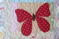 Appliqued butterfly on quilt......