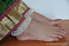 Kolusu (Anklet)- It is widely believed that by wearing this, one's energy is not wasted but re-vibrated back to one's own body. How far this is true just cannot be said, but for generations Indian women of all ages and walks wear this ornament, even today. This item made of Silver and is available in so many attractive designs.