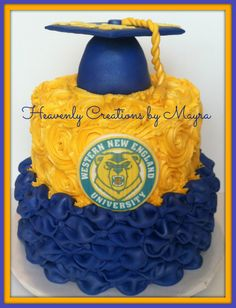 Graduation cake!!......bottom tier is pumpkin spice cake with cream cheese cinnamon filling covered with fondant used Billow technique, second tier is red velvet and vanilla cake covered with vanilla butter-cream rosettes, edible print of the logo and graduation hat made out rice crispy......Congrats Kathy!!!!!!!