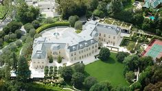 The Manor, Los Angeles, Calif.  Buyer: Petra Ecclestone, daughter of billionaire Bernie Ecclestone Sale Price: $85 million in 2011 Originally listed for $150 million, the 56,500-square foot Holmby Hills mansion is stocked with every amenity imaginable including dog grooming room, five bars, a gift-wrapping room, a flower-cutting hall with professional florist fridge, and a bowling alley.