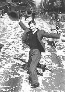 The dancing man. The end of World War Two is celebrated by people in the streets of Sydney, 1945.