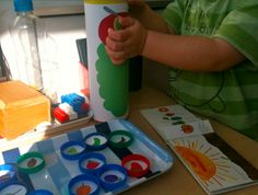 """""""Feed"""" The Very Hungry Caterpillar prop play made with a Pringles tin & bottle caps - With printables!!"""