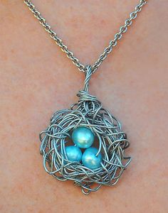 Bird's nest necklace! Wire and beads.  This could definitely be incorportated into a Reggio setting. :)))