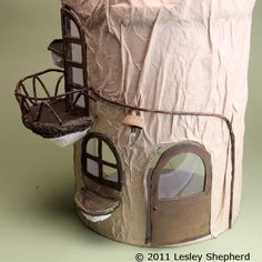Use an Empty Drink Container To Make a Miniature Tree Stump House: Add a Balcony Railing Made of Vines to the Miniature Mouse House