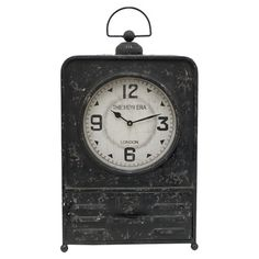 Lend a touch of vintaged charm to your desk or etagere with this handsome metal table clock, showcasing a black finish and warmly weathered details....
