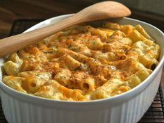 We love this dish!!   (This is the baked macaroni and cheese recipe from our favorite BBQ joint in Georgia, Sam and Daves in Marietta.  It was originally printed in the Atlanta Journal-Constitution.  Its perfect for a crowd or just anytime.  Prep time includes boiling the pasta.)