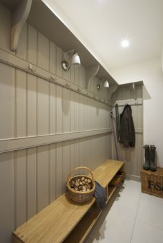A bootroom or mudroom in the entrance to a house. Panelled wall painted in Farrow and Ball Drop Cloth and a floating shelf for shoe storage. Room Interior, Interior Design Living Room, Boot Room Utility, Utility Room Storage, Hallway Storage, Porch Storage, Garage Storage, Kitchen Storage, Coat And Shoe Storage