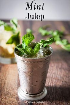 This mint julep is the perfect sipping cocktail. It is slightly sweet with a subtle mint taste and oh so refreshing! #mintjulep #bourbon #dishesdelish Easy Drink Recipes, Yummy Drinks, Delicious Recipes, Cocktail And Mocktail, Cocktail Recipes, Summer Cocktails, Derby Mint Julep Recipe, Recipe Land, Peach Sangria