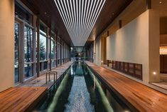 An indoor swimming pool with lighting integrated into the ceiling. Indoor Pools, Small Indoor Pool, Outdoor Pool, Lap Pools, Small Pools, Luxury Swimming Pools, Luxury Pools, Swimming Pool Designs, Luxury Resorts