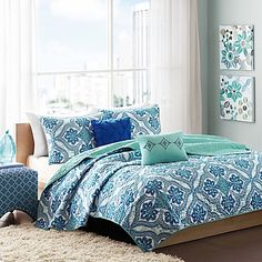 Bring a bohemian chic look to your bedroom with the eye-catching Intelligent Design Lionna Coverlet Set. Decked out in large medallions with…