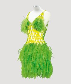 Paco Rabanne Haute Couture 1966. Mini-dress of bright green ostrich plumes and plexiglass platelets