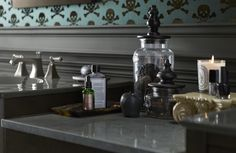 Beautiful bottles and candles evoke an apothecary look and feel that's just right for a Victorian-inspired bathroom.