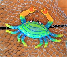 Bright colorful metal Crab Wall Art. Available in variety of colors and sizes. Wonderfully hand crafted by talented Caribbean Artisans.