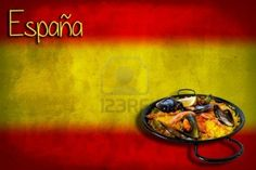 Traditional spanish dish: paella valenciana on spanish flag Stock Photo - 15759017