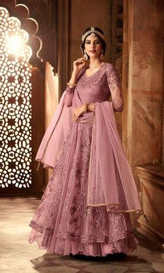 Make an elegant vision by wearing this Double Layered style anarkali salwar kameez and look your traditional best.  #floorlengthsuits #anarkalisuits #salwarkameez #partywearsuits #partyweardresses #weddingsalwarkameez #designersalwarsuits #indiandresses