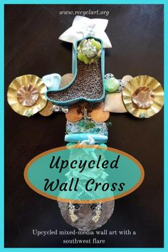 Living in New Mexico there is no shortage of anything Western. This Western Wall Cross measures inches by inches. This cross has a mint tin filled with tiny copper beads, rhinestone guns, bottle caps, boot charm, beads and Cross Wall Art, Wall Crosses, Recycled Jewelry, Old Jewelry, Mint Tins, Western Wall, Happy Trails, Pvc Pipe, Shadow Box