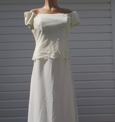 pre owned cap sleeves, material is nylon, very nice mother of the bride/groom style dress,off white, maxi length, top is layered with floral lace and the bottom is solid. underarm to underarm is 20 inch waist is 32 inch length is 48 inch smoke and pet free