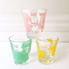 An adorable set of 3 1950s shot glasses. They all have funny drinking sayings & animals on them. I believe the elephant one is a Hazel Atlas, I