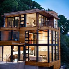 stacked #house, #modern and very contemporary use of glass, wood and concrete. likely lots of steel work for the flat ceilings and the lofty heights too.