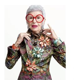 Iris Apfel wearing Alexis Bittar jewelry Spring 2015 - Love the huge flower brooches from AB & her enormous red glasses!