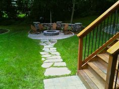 Quaint Fire pit area. Great walkway leading from back of house to seating area.