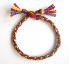 Make a friendship bracelet using a cardboard braiding loom