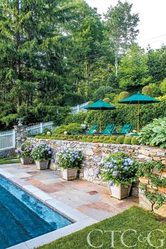 Having a pool sounds awesome especially if you are working with the best backyard pool landscaping ideas there is. How you design a proper backyard with a pool matters. Sloped Backyard, Backyard Pool Landscaping, Landscaping Ideas, Terraced Backyard, Sloped Yard, Outdoor Rooms, Outdoor Gardens, Outdoor Living, Hillside Pool