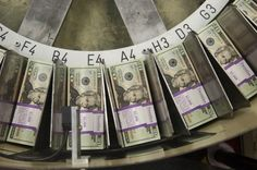 stacks paper bills   Stacks of $20 bills are cut and banded together at the Bureau of ...