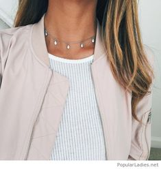 White top, nude jacket and a necklace