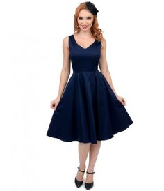 What a compelling charmer! The Missy swing is a ladylike frock in a deep navy, featuring a dainty v-neckline, tank silho...Price - $54.00-8APr866m