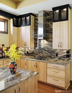 Cream colored cabinets with gray granite countertops in this ...