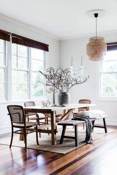 This spacious dining room in a cottage in Byron Bay is an entertainer's dream, furnished with wicker chairs and a custom-made table.  Photography: Maree Homer | Styling: Sarah Ellison