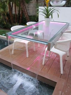 Awesome table! lights under a glass top table