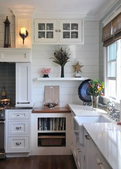 Love this white beach kitchen! Coastal Chic by designer Susan Serra ~