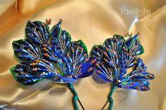 """Los """"tembleques"""" son una de las prendas que adornan la cabeza de la """"empollerada"""". En sus inicios se utilizaban flores naturales, luego se confeccionaban con escamas de pescado, hoy la mayoria son de perlas y cristales.  Que tal este par de pavo reales de @inspiracion_del_istmo confeccionados con escamas de pescado.  Admire bellezas como esta en el Desfille de las Mil Polleras! #tradicion #folclor #milpolleras #azuero #jewelrydesign #amorporlapollera #hechoamano #tembleques #joyero #lujo…"""